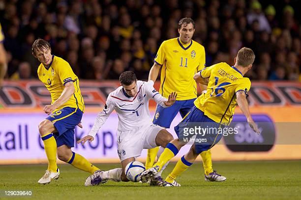 Kim Kallstrom of Sweden, Robin van Persie of Holland, Johan Elmander of Sweden during the EURO 2012 Qualifying match between Sweden and Netherlands...