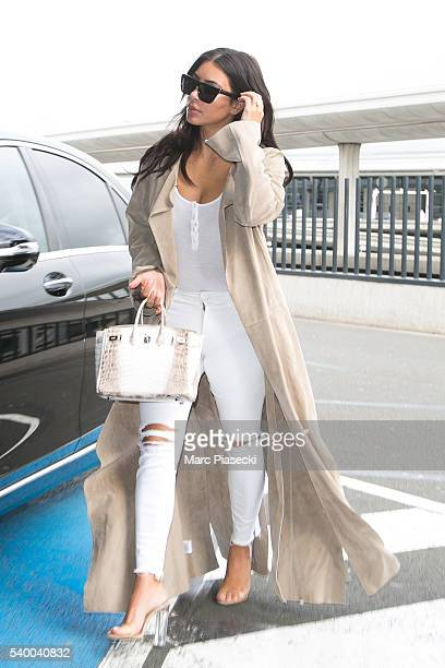 Kim Kardashan West arrives at CharlesdeGaulle airport on June 14 2016 in Paris France