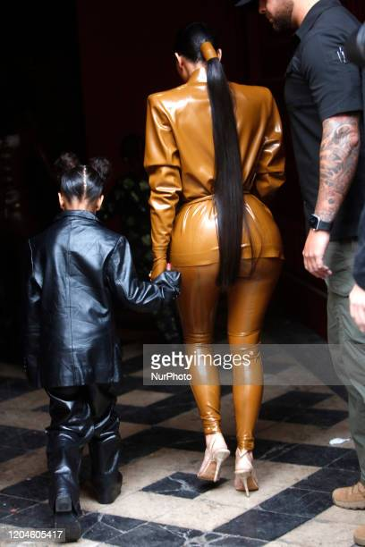 Kim Kardashian and daughter North West arrive at the Theatre des Bouffes du Nord to attend Kanye West's Sunday Service on March 01 2020 in Paris...