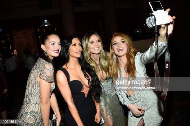 Kim Kardashian and Heidi Klum pose with guests the amfAR New York Gala 2019 at Cipriani Wall Street on February 6 2019 in New York City