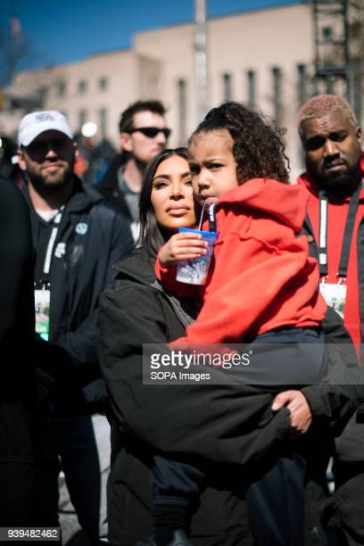 Kim Kardashian and Husband Kanye West along with Daughter North West show up to support March For Our Lives Tens of thousands of Americans took to...