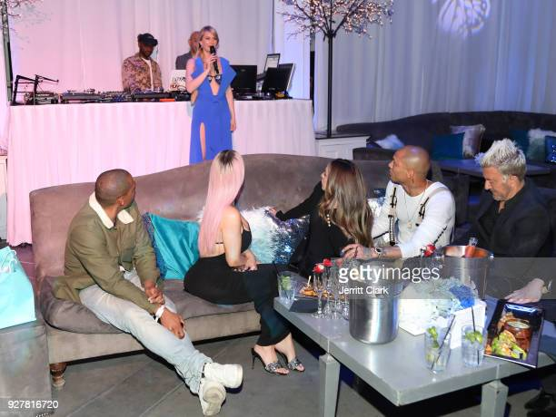 Kim Kardashian and Jeremy Meeks look on as Marina Acton speaks during the release of Marina Acton's new single Fantasize at Boulevard3 on March 5...
