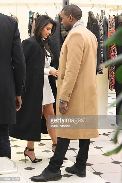 Kim Kardashian and Kanye West are seen at the 'BALANCIAGA' store on January 11 2013 in Paris France