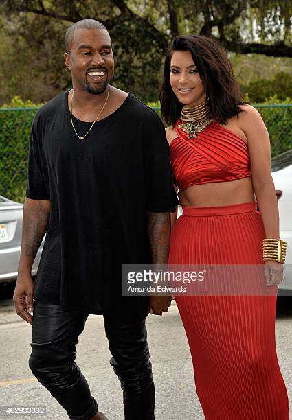 Kim Kardashian and Kanye West arrive at the Roc Nation Grammy Brunch 2015 on February 7 2015 in Beverly Hills California