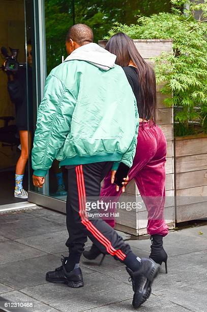 Kim Kardashian and Kanye West arrive at their Manhattan apartment on October 3 2016 in New York City