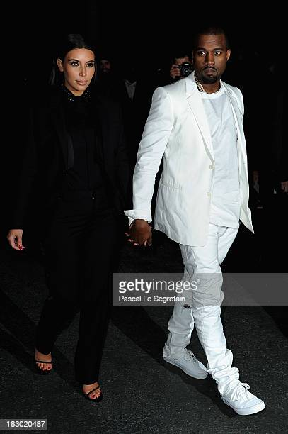 Kim Kardashian and Kanye West attend Givenchy Fall/Winter 2013 ReadytoWear show as part of Paris Fashion Week on March 3 2013 in Paris France