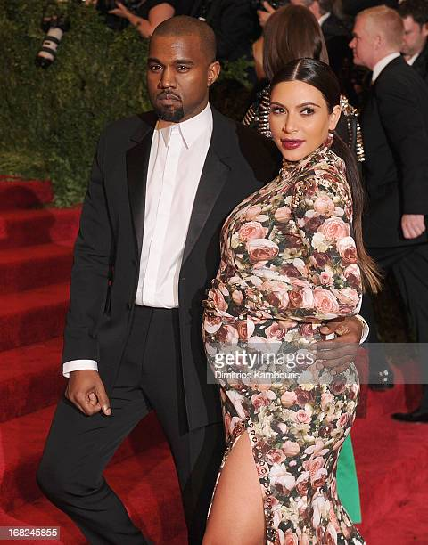 Kim Kardashian and Kanye West attend the 2013 Costume Institute Gala PUNK Chaos to Couture at Metropolitan Museum of Art on May 6 2013 in New York...
