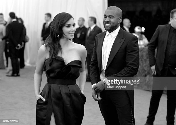 Kim Kardashian and Kanye West attend the 'Charles James Beyond Fashion' Costume Institute Gala at the Metropolitan Museum of Art on May 5 2014 in New...