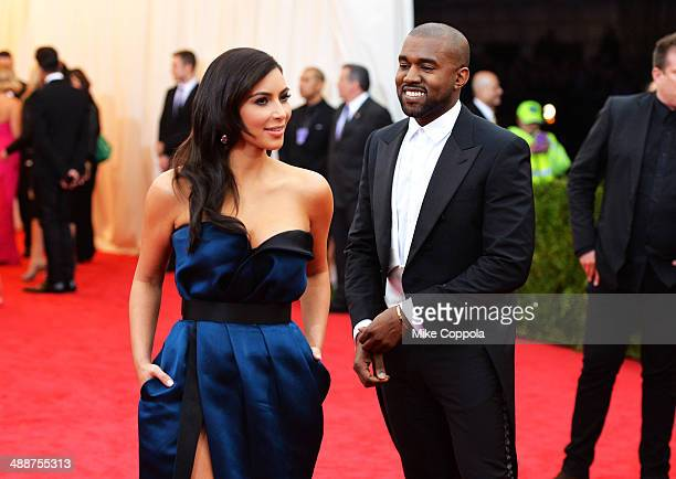 Kim Kardashian and Kanye West attend the Charles James Beyond Fashion Costume Institute Gala at the Metropolitan Museum of Art on May 5 2014 in New...