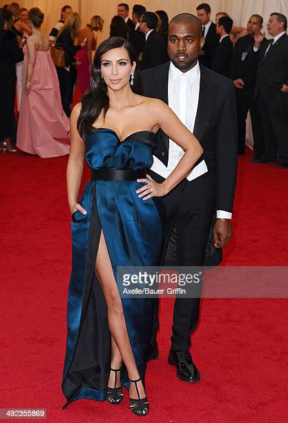 Kim Kardashian and Kanye West attend the 'Charles James: Beyond Fashion' Costume Institute Gala at the Metropolitan Museum of Art on May 5, 2014 in...