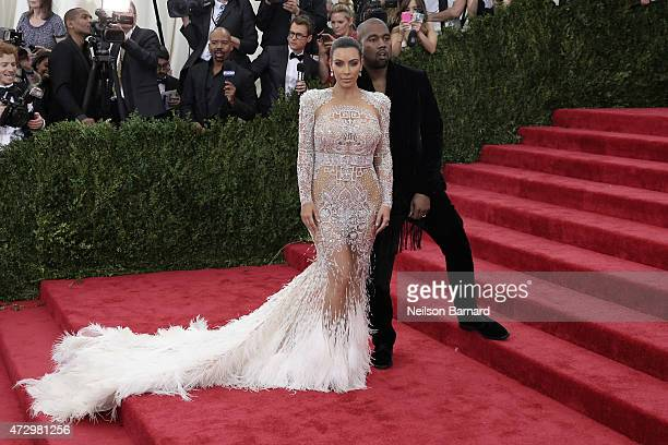 "Kim Kardashian and Kanye West attend the ""China: Through The Looking Glass"" Costume Institute Benefit Gala at the Metropolitan Museum of Art on May..."
