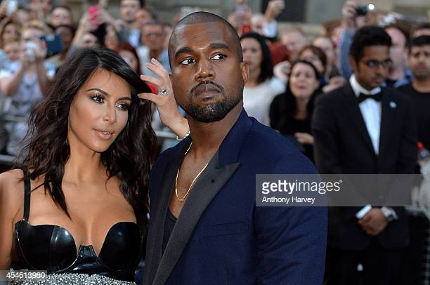 Kim Kardashian and Kanye West attend the GQ Men of the Year awards at The Royal Opera House on September 2 2014 in London England