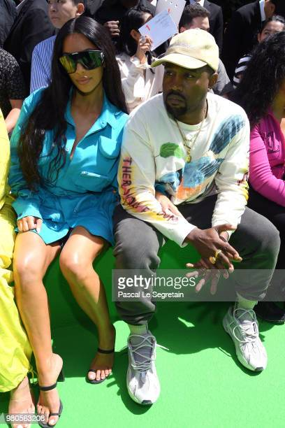 Kim Kardashian and Kanye West attend the Louis Vuitton Menswear Spring/Summer 2019 show as part of Paris Fashion Week on June 21 2018 in Paris France