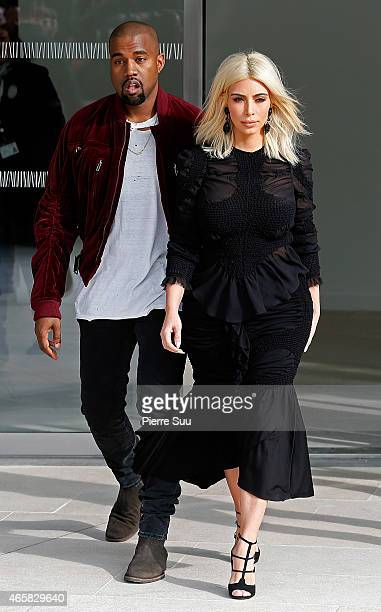 Kim Kardashian and Kanye West attend the Louis Vuitton show as part of the Paris Fashion Week Womenswear Fall/Winter 2015/2016 on March 11 2015 in...