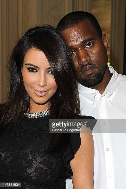 Kim Kardashian and Kanye West attend the Valentino HauteCouture show as part of Paris Fashion Week Fall / Winter 2012/13 at Hotel Salomon de...