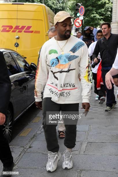 Kim Kardashian and Kanye West leave a restaurant on June 21 2018 in Paris France