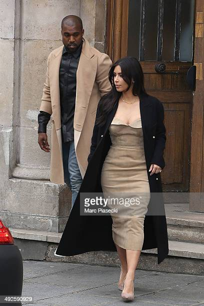 Kim Kardashian and Kanye West leave the 'Maison Martin Margiela' showroom on May 21, 2014 in Paris, France.
