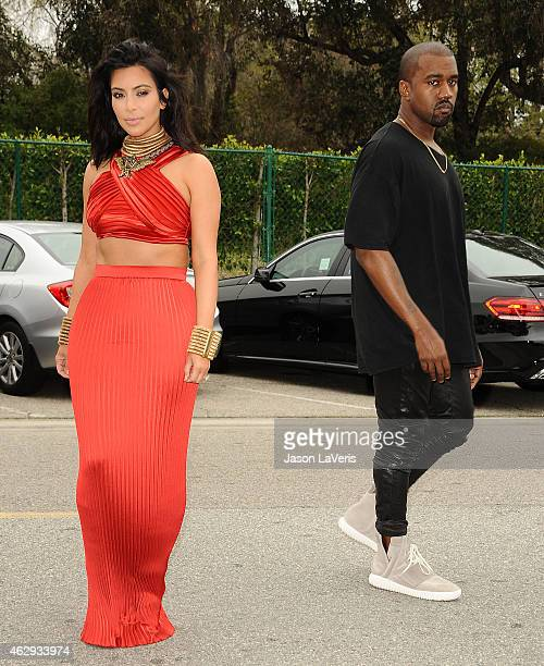 Kim Kardashian and Kanye West speculated to be wearing the Yeezy 3 sneakers Yeezy 750 Boost attend the Roc Nation Grammy brunch on February 7 2015 in...