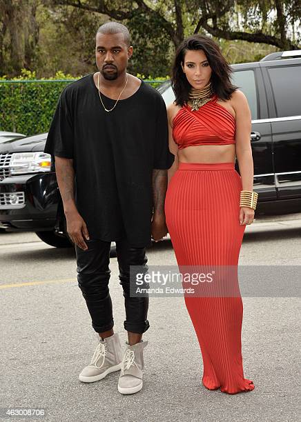 Kim Kardashian and Kanye West speculated to be wearing the Yeezy 3 sneakers 'Yeezy 750 Boost' arrive at the Roc Nation Grammy Brunch 2015 on February...