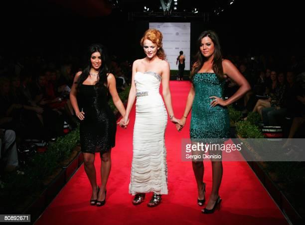 Kim Kardashian and Khloe Kardashian appear on the catwalk following the Ruth Tarvydas show on the first day of the Rosemount Australian Fashion Week...