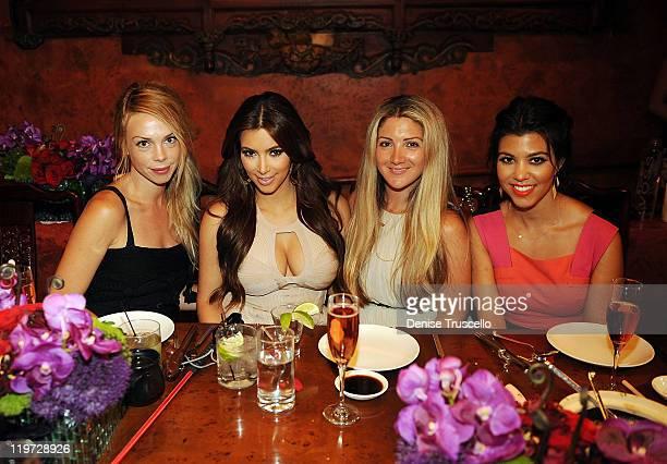 Kim Kardashian and Kourtney Kardashian attend Kim Kardashian's bachelorette dinner at TAO Bistro at the Venetian on July 23 2011 in Las Vegas Nevada