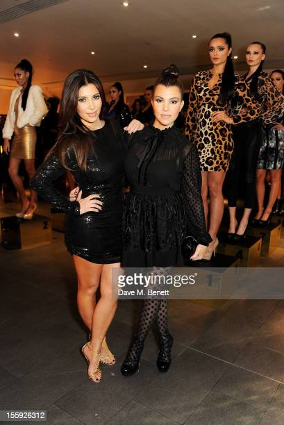 Kim Kardashian and Kourtney Kardashian attend the Kardashian Kollection launch for Dorothy Perkins at Aqua on November 8 2012 in London England