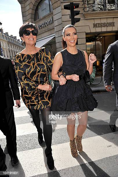 Kim Kardashian and Kris Jenner walk to the Gucci boutique on September 16 2010 in Paris France