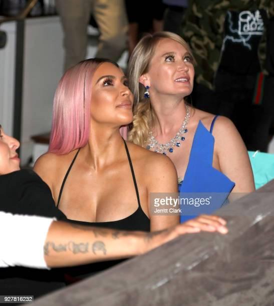 Kim Kardashian and Marina Acton watch the premiere of Marina Acton's new single Fantasize at Boulevard3 on March 5 2018 in Hollywood California