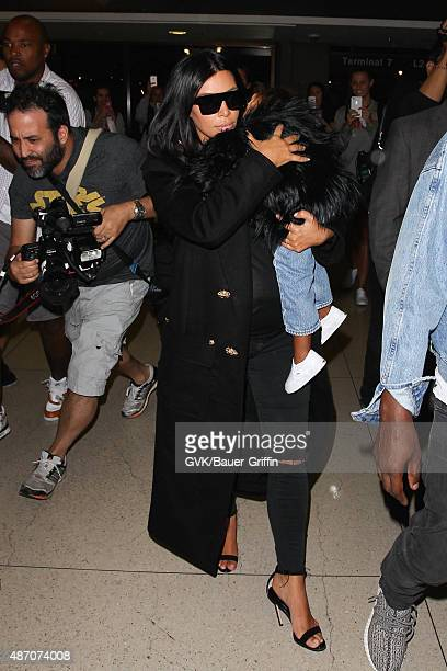 Kim Kardashian and North West are seen at LAX on September 05 2015 in Los Angeles California