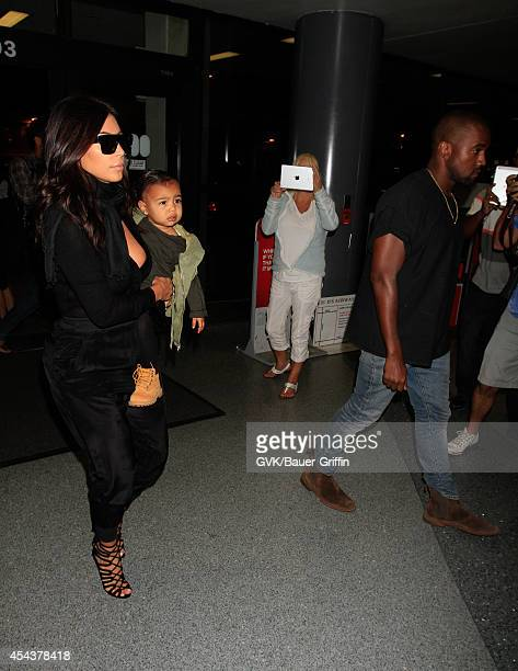 Kim Kardashian and North West with Kanye West are seen at LAX on August 30 2014 in Los Angeles California