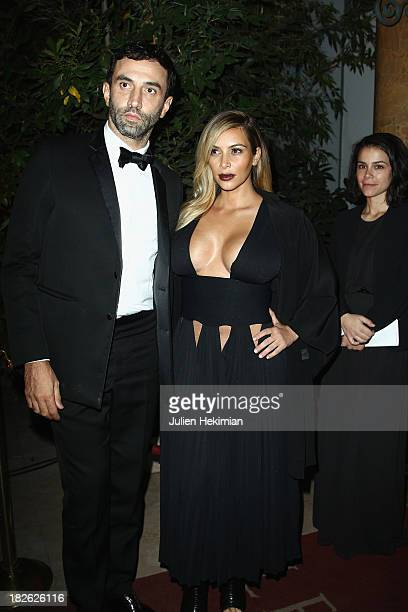 Kim Kardashian and Riccardo Tisci attend the 'Mademoiselle C' cocktail party at Pavillon Ledoyen on October 1 2013 in Paris France
