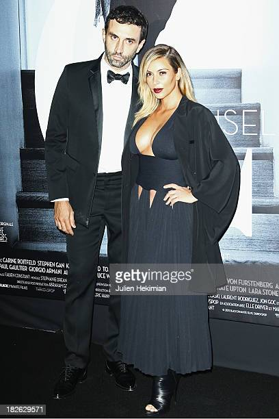 Kim Kardashian and Riccardo Tisci attend the 'Mademoiselle C' Paris Premiere at Publicis Cinema on October 1 2013 in Paris France