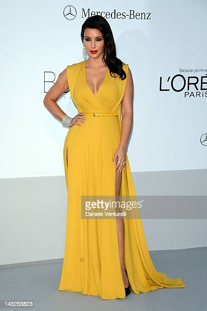 Kim Kardashian arrives at 2012 amfAR's Cinema Against AIDS during the 65th Annual Cannes Film Festival at Hotel Du Cap on May 24 2012 in Antibes...