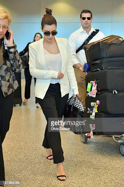 Kim Kardashian Arrives at Miami International Airport on December 2 2012 in Miami Florida