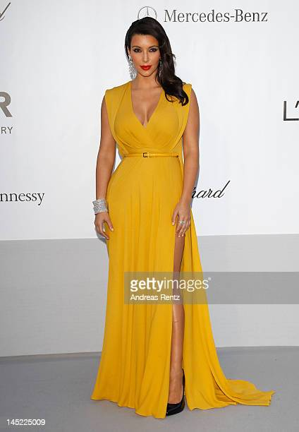Kim Kardashian arrives at the 2012 amfAR's Cinema Against AIDS during the 65th Annual Cannes Film Festival at Hotel Du Cap on May 24 2012 in Cap...