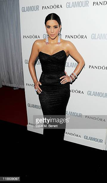 Kim Kardashian arrives at the Glamour Women of the Year Awards at Berkeley Square Gardens on June 7 2011 in London England