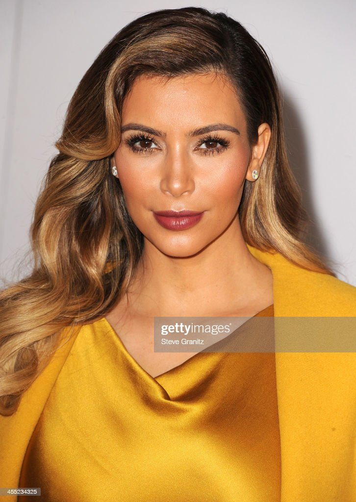 Kim Kardashian arrives at the The Hollywood Reporter's Women In Entertainment Breakfast Honoring Oprah Winfrey at Beverly Hills Hotel on December 11, 2013 in Beverly Hills, California.