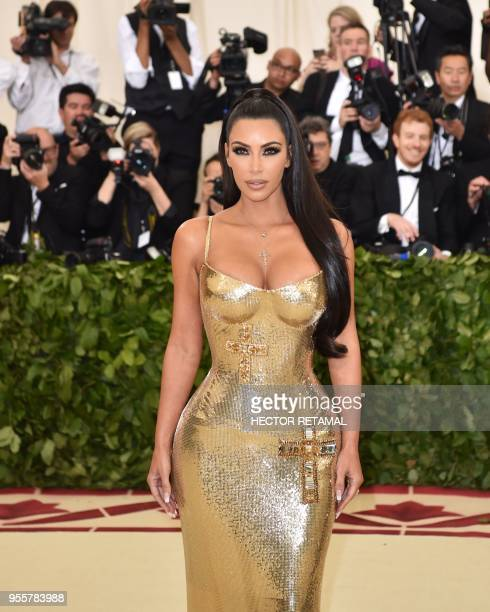 Kim Kardashian arrives for the 2018 Met Gala on May 7 2018 at the Metropolitan Museum of Art in New York The Gala raises money for the Metropolitan...