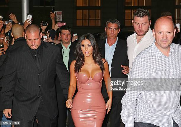 Kim Kardashian arrives surrounded by security men to promote her new fragrance 'Fleur Fatale' at a Spice Market event on November 18 2014 in...