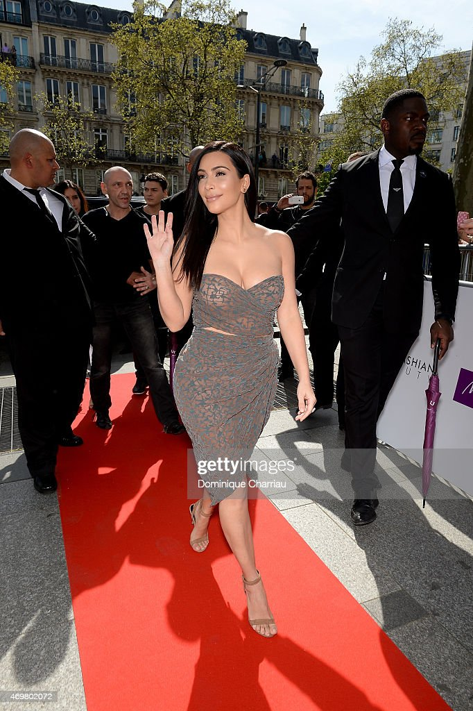 Kim Kardashian arrives to introduce her 'Kardashian Beauty Hair' line at Marionnaud Champs Elysees on April 15, 2015 in Paris, France.