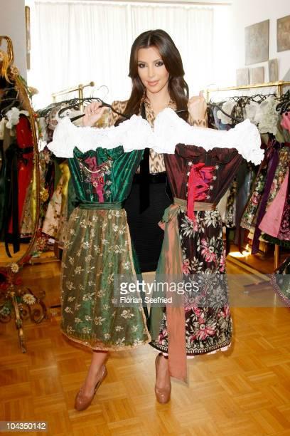 Kim Kardashian attends the dirndl/dress fitting for her visit of the Oktoberfest 2010 at Lola Paltinger Lollipop Alpenrock store during her Munich...