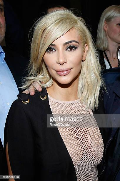 Kim Kardashian attends the Lanvin show as part of the Paris Fashion Week Womenswear Fall/Winter 2015/2016 Held at Ecole des Beaux Arts on March 5...
