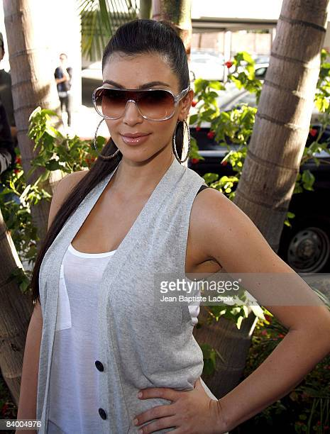 Kim Kardashian attends the unveiling of Khloe Kardashian's PETA Fur I'd Rather Go Naked Billboard on December 10 2008 in West Hollywood California