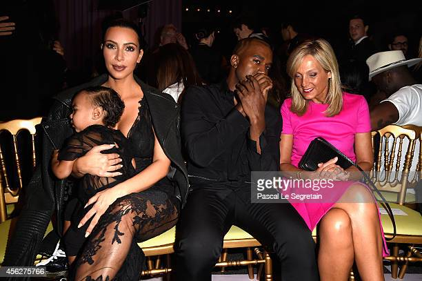 Kim Kardashian baby North West Kanye West and Helene Arnault attend the Givenchy show as part of the Paris Fashion Week Womenswear Spring/Summer 2015...