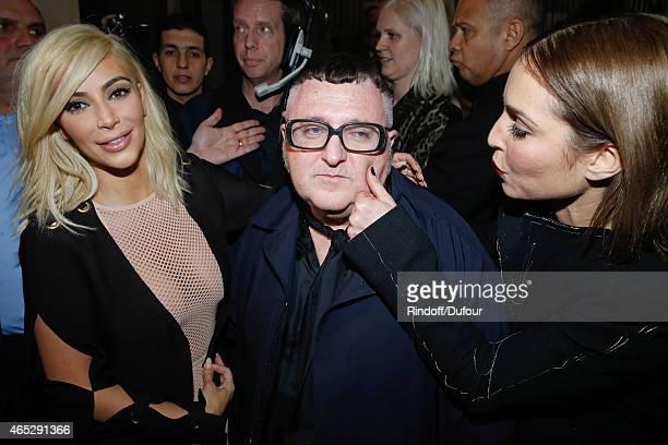 Kim Kardashian Fashion Designer Alber Elbaz and actress Noomi Rapace pose after the Lanvin show as part of the Paris Fashion Week Womenswear...