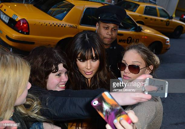 Kim Kardashian greets her fans on the streets of Manhattan on March 26 2013 in New York City