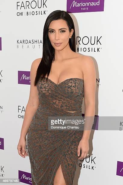 Kim Kardashian introduces 'Kardashian Beauty Hair' line at Marionnaud Champs Elysees on April 15 2015 in Paris France