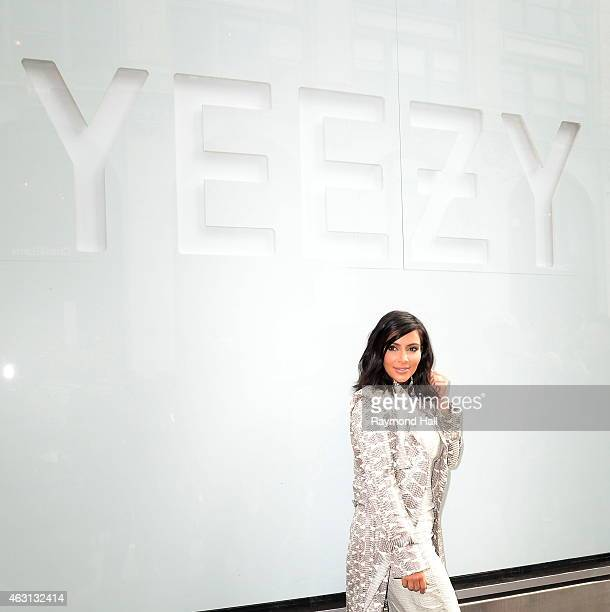 Kim Kardashian is seen at a photoshoot outside the Adidas Store in Soho where the new Kanye West Adidas Originals 'Yeezy Boost' sneakers are on...