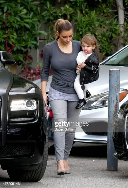 Kim Kardashian is seen carrying her niece, Penelope Disick on December 16, 2013 in Los Angeles, California.