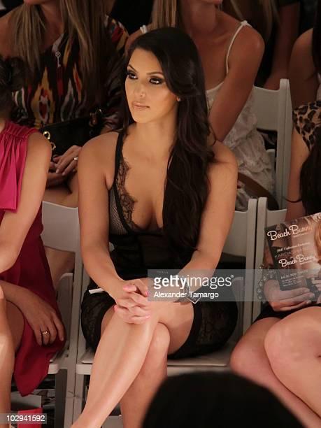 Kim Kardashian is seen sitting front row for the Beach Bunny Swimwear show during Mercedes-Benz Fashion Week Swim 2011 on July 16, 2010 in Miami...